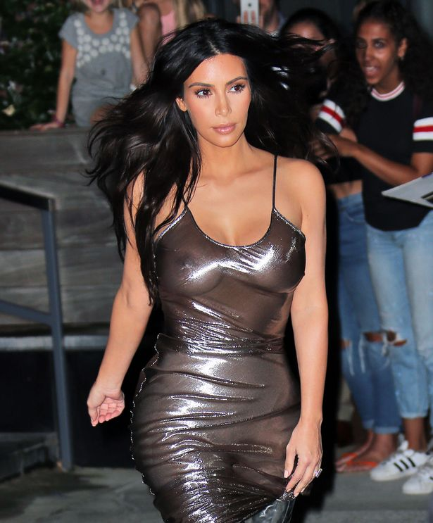 kim-kardashian-wears-a-see-through-shiny-dress-showing-off-her-nipples-when-heading-to-kanye-wests